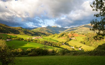 Rolling hills with cloudy sky and shadow in the foothills of the Pyrenees in Spanish Basque country