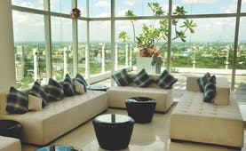 Cinnamon Red Sri Lanka lobby indoor seating area large glass windows view over city