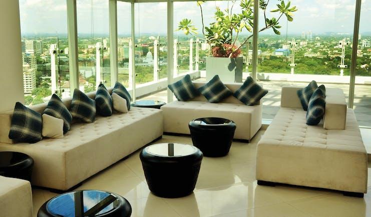 Cinnamon Red Sri Lanka lobby indoor seating area large glass windows view over city