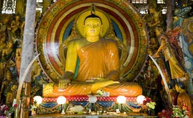 Gangaramaya Temple in Colombo, colourful Buddha statue with lights and colourful details