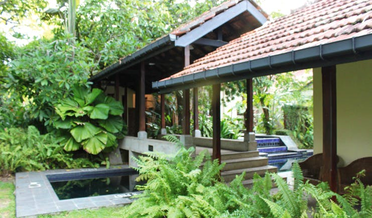Havelock Place Bungalow Sri Lanka garden pool stone bridge blue tiles