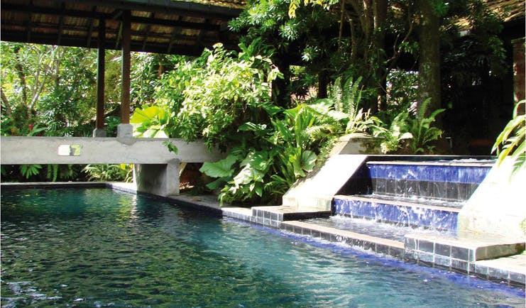 Havelock Place Bungalow Sri Lanka pool with blue tiles stone bridge and plants