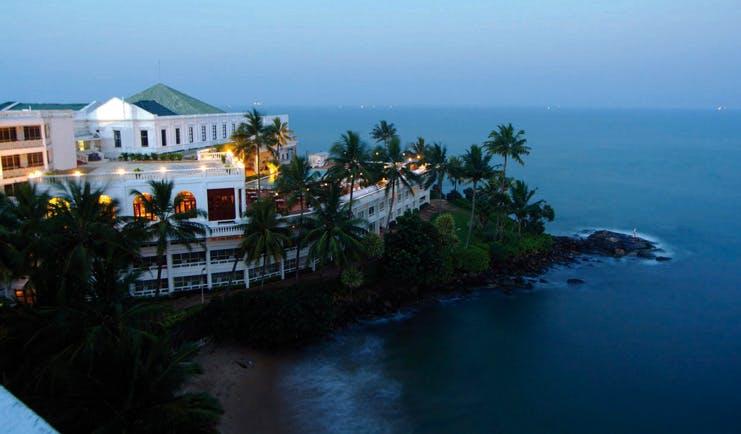 Mount Lavinia Hotel Sri Lanka aerial view day white hotel coast palm trees