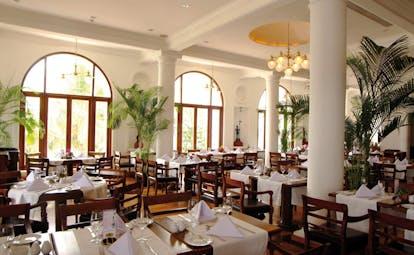 Mount Lavinia Hotel Sri Lanka Governor's restaurant indoor dining area large windows palms