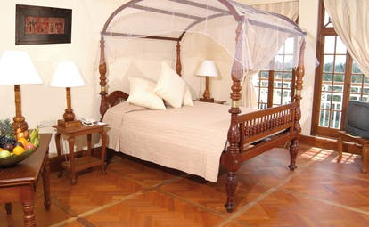 Mount Lavinia Hotel Sri Lanka Governor's wing suite four poster bed desk with fruit
