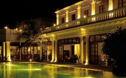 Mount Lavinia Hotel Sri Lanka pool terrace white building with terrace next to pool at night