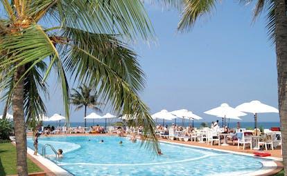 Mount Lavinia Hotel Sri Lanka poolside outdoor pool with sun loungers umbrellas and palm trees