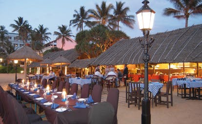Mount Lavinia Hotel Sri Lanka Seafood Cove outdoor dining area thatched roof evening