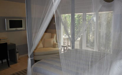Paradise Road Tintagel Sri Lanka suite bedroom four poster bed armchair and balcony