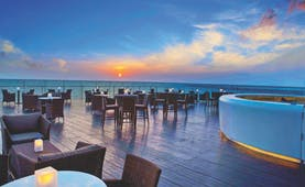 The Kingsbury Sri Lanka terrace at sunset outdoor seating area overlooking the sea