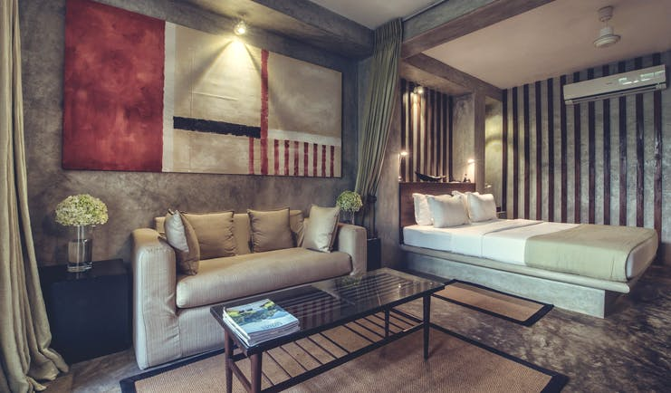 The Lake Lodge garden suite, double bed, sofa, modern decor in muted tones