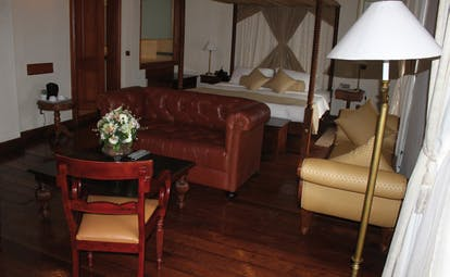 Galle Face Hotel Sri Lanka bedroom lounge sofa chairs chaise longue four poster bed