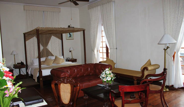 Galle Face Hotel Sri Lanka bedroom four poster bed leather sofa chaise longue