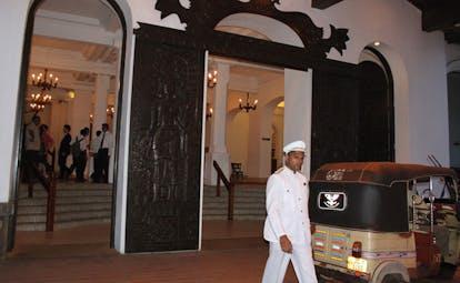 Galle Face Hotel Sri Lanka entrance carved door vintage car and uniformed driver