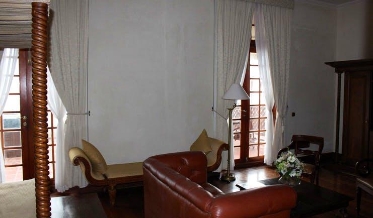 Galle Face Hotel Sri Lanka four poster sofa chaise longue balcony