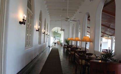 Galle Face Hotel Sri Lanka indoor terrace with tables and lamps