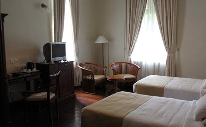 Galle Face Hotel Sri Lanka twin bedroom chairs and television