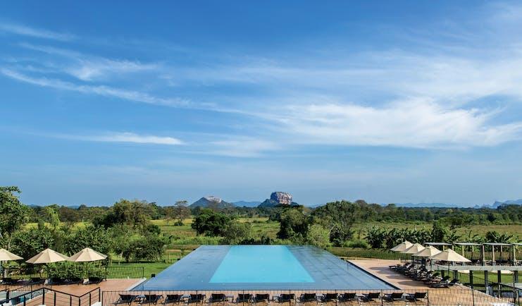 Aliya Sri Lanka infinity pool views across countryside mountains in distance
