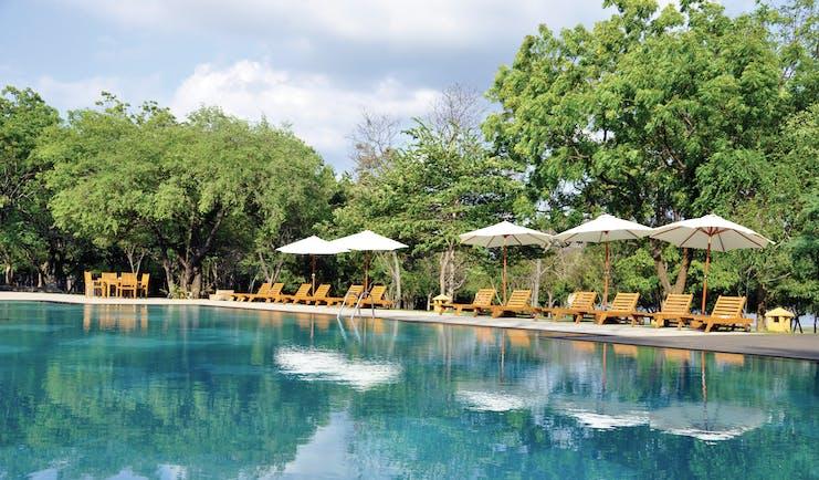 Amaya Lake Resort Sri Lanka pool sun loungers umbrellas
