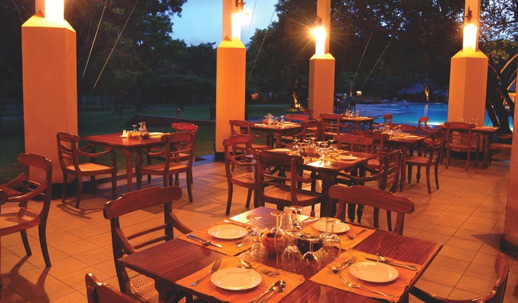 Amaya Lake Resort Sri Lanka restaurant patio outdoor dining area overlooking pool