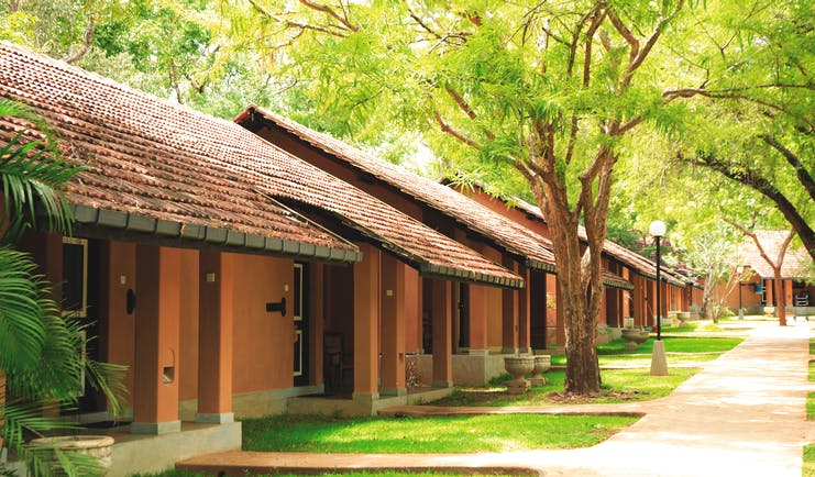 Chaaya Village Sri Lanka cottages exterior pathway lawns trees