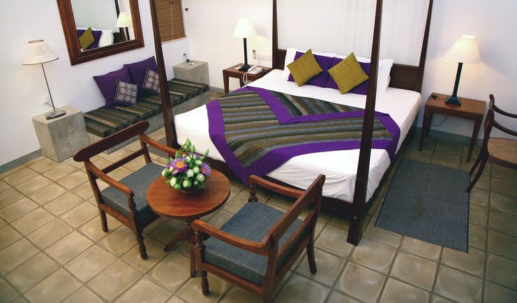 Chaaya Village Sri Lanka four poster bed armchairs modern décor