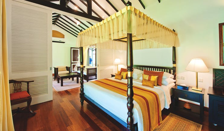 Cinnamon Lodge Sri Lanka superior suite canopied four poster bed separate living area modern décor