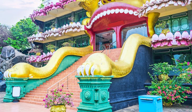 Dambulla Golden Temple entrance, colourful bright dragon carving, intricate design