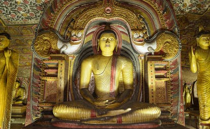Rock Temple of Dambulla, Buddha shrine, large colourful statue, intricate carvings