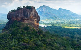 Sigiriya rock, sprawling landscape, mountains in background