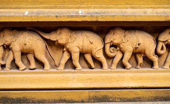 A stone carving of elephants, intricate beautiful details, found in Polonnaruwa in the Cultural Triangle