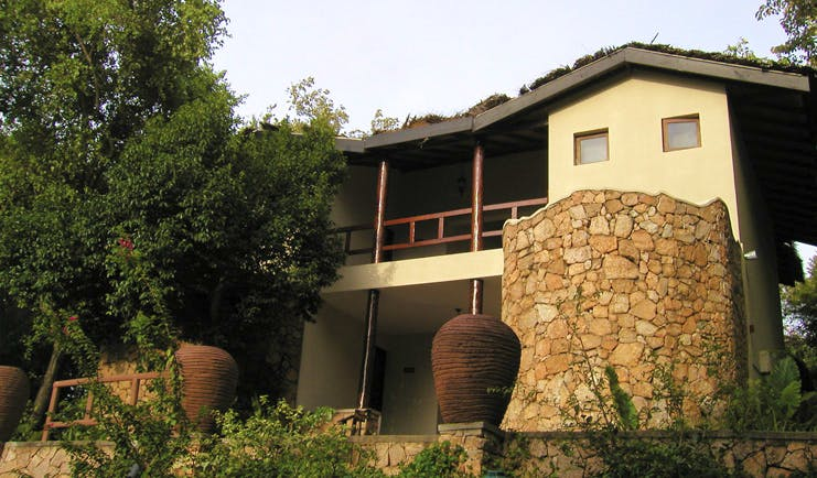 Deer Park Sri Lanka cottage exterior building stonework balconies trees urns