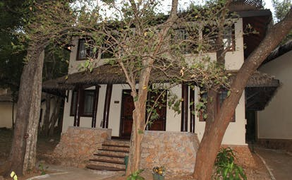 Deer Park Sri Lanka duplex cottage exterior stone steps building trees