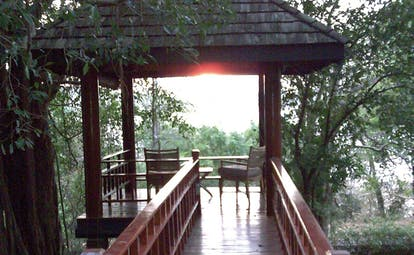 Deer Park Sri Lanka lookout view two chairs in a pagoda overlooking forest