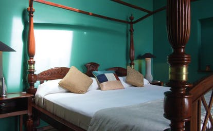The Elephant Corridor Sri Lanka green bedroom four poster bed