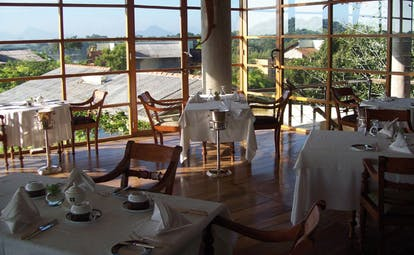 The Elephant Corridor Sri Lanka indoor dining room with large panoramic windows