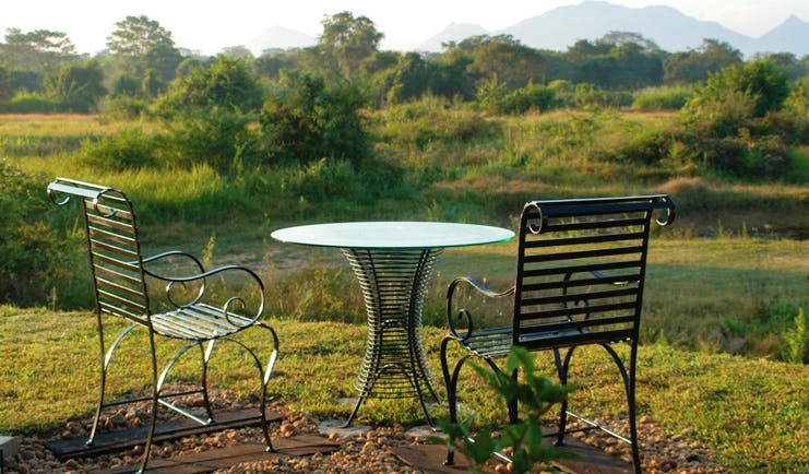 The Elephant Corridor Sri Lanka outdoor seating with garden and mountain view