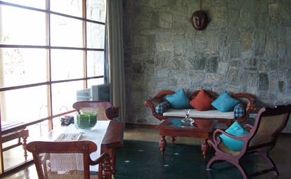 The Elephant Corridor Sri Lanka rustic lounge stone walls sofa and chairs