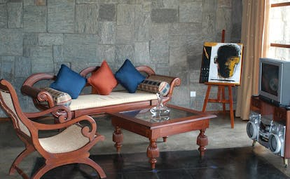 The Elephant Corridor Sri Lanka suite lounge wooden sofa and chair easel with picture and television