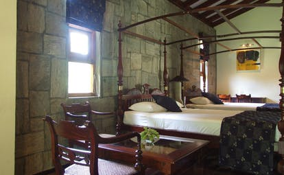 The Elephant Corridor Sri Lanka twin double bedroom four poster stone walls