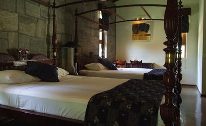 The Elephant Corridor Sri Lanka twin four poster bedroom stone walls desks