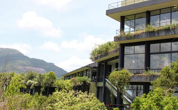 Heritance Kandalama Sri Lanka hotel exterior hotel with balconies and large windows mountain and rainforest view