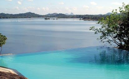 Heritance Kandalama Sri Lanka infinity pool with mountain and sea view