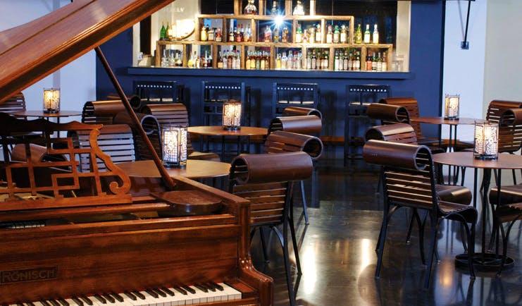 Heritance Kandalama Sri Lanka Kachchan bar grand piano seating and bar area