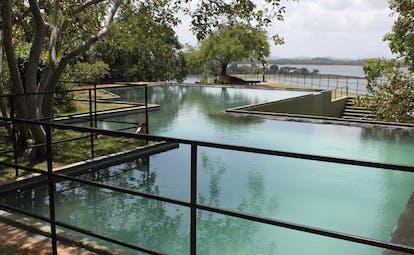Heritance Kandalama Sri Lanka outdoor swimming pool geometric shaped pool trees and ocean view