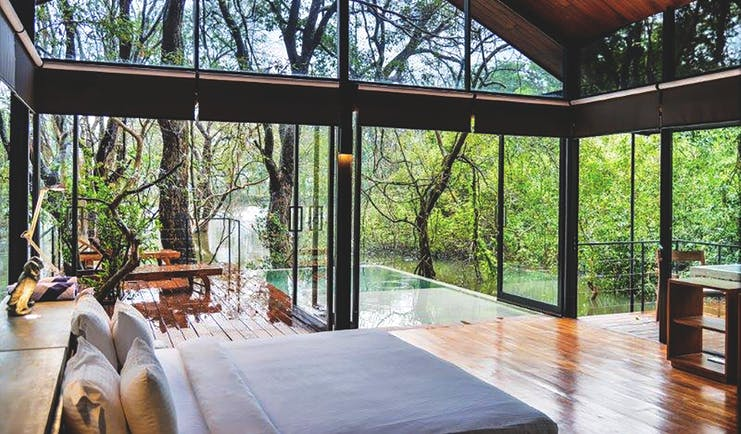 Kalundewa Retreat kumbuk chalet, double bed, terrace with plunge pool, view of tops of trees