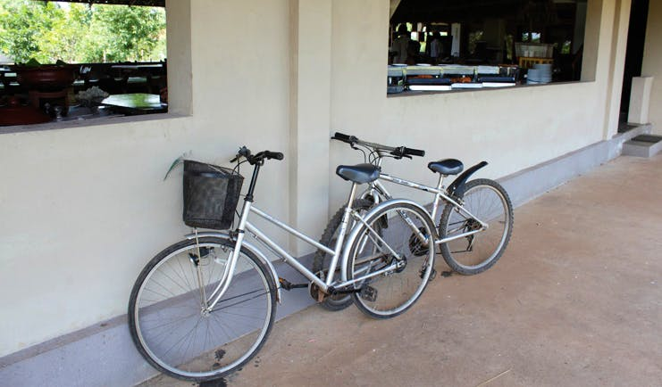 Kassapa Lion Rock Sri Lanka bicycles leaning against a wall