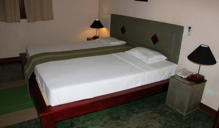 Kassapa Lion Rock Sri Lanka green bedroom minimalist decor
