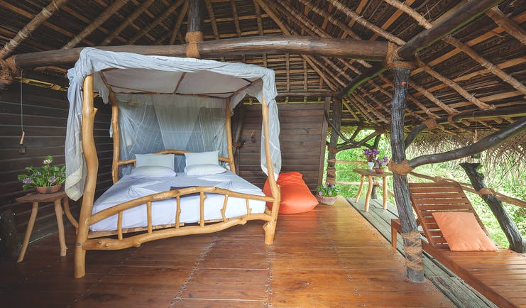 The Mudhouse hut interior, double bed, tree house