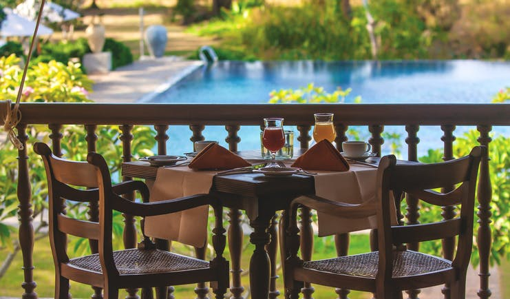 Ulagalla Resort dining terrace, outdoor dining area overlooking pool